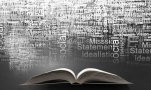 Opened book and business leadership conceptual words